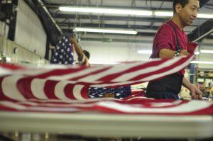 Man folding American Flag